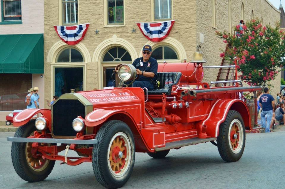 Lockhart Fire Chief Jerry Doyle driving the 1921 LaFrance Fire Truck  2014 Chisholm Trail Roundup Parade